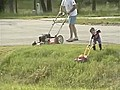 Dad Mows Lawn While Son Helps  | BahVideo.com