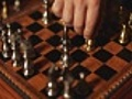 Close-up of hand playing chess at two angles  | BahVideo.com